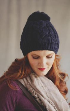 I imagine wearing this cozy beanie with an equally cozy sweater this winter. The neutral navy color goes with everything! $22