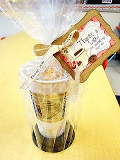 Cute way to wrap a gift card for a coffee lover. Travel cup from the store, brown crinkle paper inside, then gift card, wrap with cellophane and tie with ribbon and cute card.