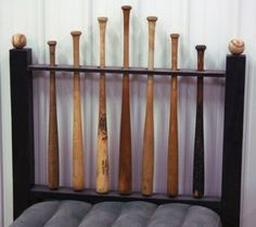 Baseball headboard: Drill the holes first, cut the board in half, put it back together and hide the seam. The bats are spinnable by putting a nail up through the bottom.    If we have a little boy one day, I definitely wanna make this for his room. So cute!