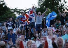 Fans celebrate on Murray Mount. Photo: Jonathan Brady/PA Wire
