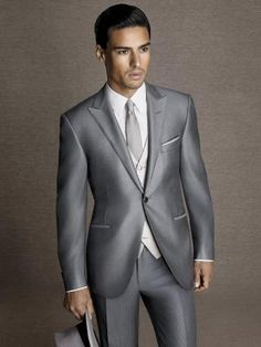 Dot-effect glossy wool/silk straight morning #suit.  Silver grey one-button #jacket with peak lapels and champagne #waistcoat. Pinstripe #trousers without pleats, 19 cm base. #formalwear14 #men