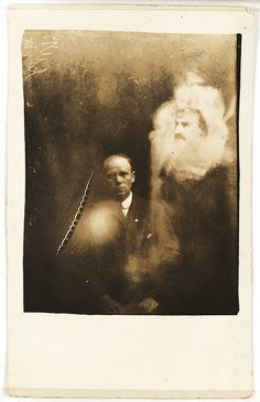 A clergyman and two spirits  The clergyman and his wife had attended a seance at which a voice was heard, claiming to be their stillborn daughter - whom the 'spirit people' had named Rose. The voice asked them to sit for a psychic photograph, telling them she would try to appear in it. 'Rose' is not clearly apparent in the image. The image of the man was identified as the long-deceased father of the clergyman.