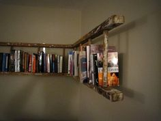 antique ladder that has been made into a 90 degree corner bookshelf. It attaches to the wall with 4 'L' brackets, so it can hold plenty of weigh