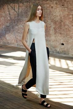 """The Row delivered another flawless collection filled with minimal silhouettes rendered in luxurious fabrics. This textured tunic with waist-high slits is effortlessly elegant."""
