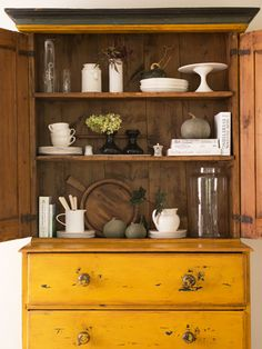How beautiful is this antique hutch? The vibrant mustard hue is original to the piece.