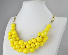 Hey, I found this really awesome Etsy listing at http://www.etsy.com/es/listing/114364113/yellow-beads-jewelry-yellow-cluster