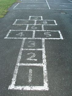 I spent many hours playing hop scotch on the street.