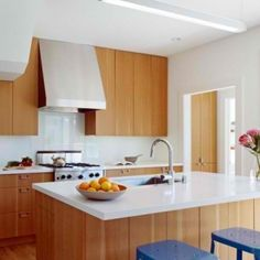 Modern kitchen with fir cabinets and white Silestone countertops