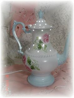custom design.  vintage silver teapot into a night light by Judy Mullins