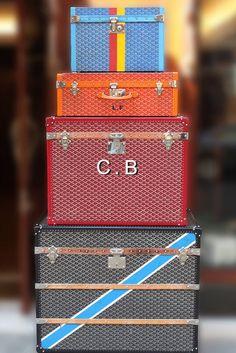 Monogrammed Goyard luggage.