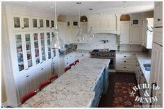 white cabinets, light granite kitchen island