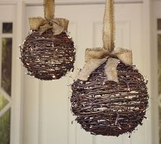 Wrap grapevine spheres in string lights and hang by burlap ribbons