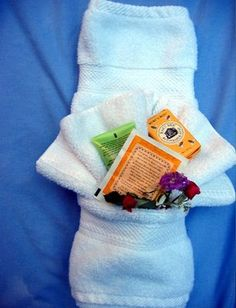 Fancy Shmancy Towel Fold Tutorial!  SO neat..fold a hand towel to form a pocket. fill the pocket with goodies!!!