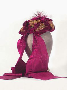 """Caroline Reboux velvet hat, trimmed with silk moiré ribbons and feathers, c.1870-80. Label: """"Caroline Reboux/23 Rue de la paix."""""""