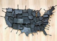 Map of USA made out of cast iron skillets.
