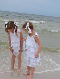 Sisters Enjoying Getting Their Feet Wet At The Beach....