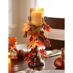 Our Harvest Leaf Candle Holder is a one-of-a-kind decoration with its amber glass and autumn accents! It would look fabulous on any table. #kirklands #harvest
