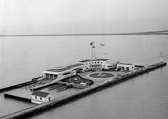 Abandoned Coast Guard Station on Lake Erie in Cleveland, Ohio(Completed in August, 1940 Building was abandoned by the US Government approx. 2000. Then the city of Cleveland bought the facility in 2004 for $1 from local developer Jeff Jacobs. Restoration and repair is virtually non-existent and the building is still in bad shape)