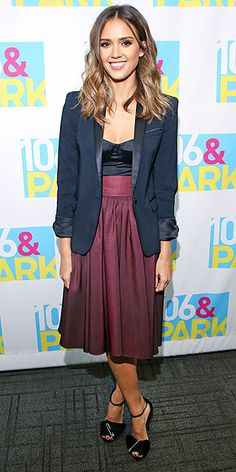 JESSICA ALBA Someone's ready for fall. The Sin City actress stops by BET in N.Y.C. in a high-waisted Katherine Kidd skirt and a bustier topped with a The Kooples blazer. If this seems basic for Jessica, note the punk touch on her Giuseppe Zanotti heels: safety pins.