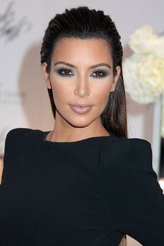 It's all focus on the eyes for Kim Kardashian with emphasis on the bottom lashes - do you dare to use falsies on your top AND bottom this Christmas? #party #lashes