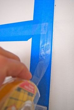 Use double-sided tape or hot glue OVER painter's tape to keep from ruining the walls.   37 Insanely Smart School Teacher Hacks