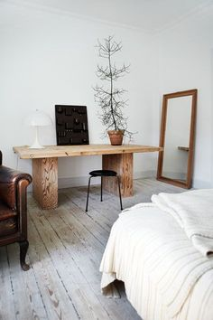 grey wood floors, natural wood accents, large standing mirror