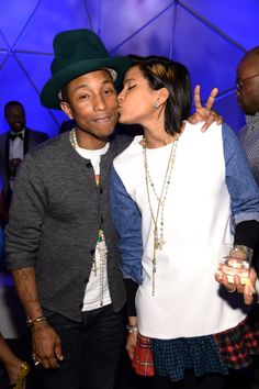 Pharrell Williams got a sweet smooch from his wife, Helen Lasichanh, at his 41st birthday celebration in NYC.