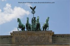 Quadriga statue sits atop the Brandenburger Tor (gate) Berlin Germany 2014. The statue is called the Goddess of Victory.