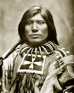 This Minneconjoux Sioux young man was named Scorched Lightening. Note the magnificent string of large bear claws around his neck. The bear was held in reverence among Northern Plains tribes and admired for its great strength and courage.  Photographed by L. A. Huffman