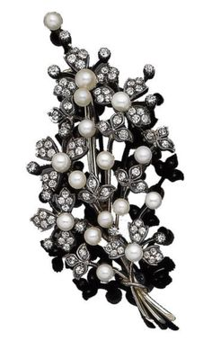 A pearl and diamond spray brooch, circa 1870 Set throughout with 3.8mm-4.8mm pearls, the petals and leaves set with old brilliant-cut diamonds, diamonds approx. 2.05cts total, length 7.6cm