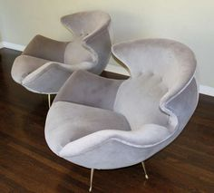 Anonymous; Brass-Legged Lounge Chairs, 1950s.
