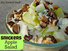 Snickers Apple Pudding Salad- this is a family favorite! We have it at every BBQ and potluck dinner . . .makes a great dessert (or even a side dish!). SixSistersStuff.com #recipe #snickers #dessert