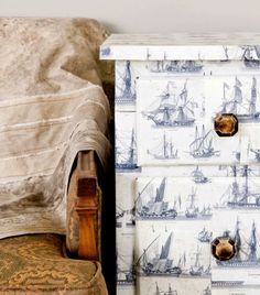Decoupaged dresser with nautical sailboat motif paper.