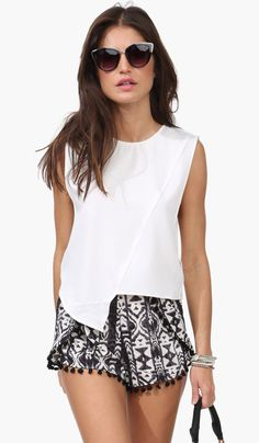 Asymmetric top and printed shorts