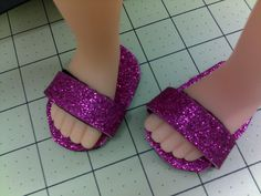 PP wrote - I just made these sandals for my granddaughters 18 inch dolls using the tutorial I have pinned on my doll clothes board. I used the glitter foam with the adhesive. I used the black for the sole. The tutorial used the same glitter for the sole but I chose not too.