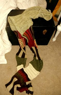 This is a hooded scarf made from sweater scraps. I am loving upcycling old sweaters! I also have a pic of me wearing it that shows how it lays!