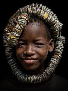 Africa | A Tsemai (Tsemay/Tsamai) girl wearing a unique headdress made of bottle caps.  Near the town of Weyto, Omo Valley | ©Stefan Cruysberghs