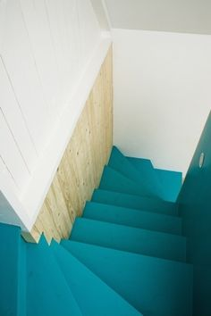 Turquoise stairs. Farmhouse in the southernmost Swedish region of Skåne, converted into a summerhouse by LASC Studio, a Copenhagen-based office founded in 2007 by the Swedish/German architect Jonas Labbé and the Dutch architect Johannes Schotanus.  Photography by Laura Stamer.