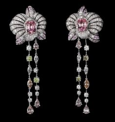 Platinum, two oval-shaped pink sapphires totaling 3.95 carats, pink sapphires, green diamonds, brilliants.