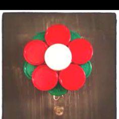 Make a Flower for your badge out of medication vial caps! badg idea