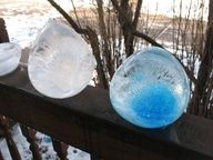 Fill balloons with colored water and freeze them..giant ice gems!