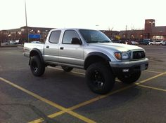 """Nice stance...ready for war I would say!  2002 Tacoma Double Cab TRD  Bilstein 5100s front and rear, Eibach coils, Deaver 8 leaf packs  Pro-Comp 16x8"""" alloys w/ 255/85-16 KM2s"""