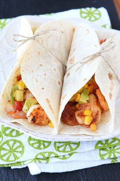 Love these Firecracker Shrimp Tacos with Avocado Corn Salsa. Fresh, spicy, and bursting with flavor!