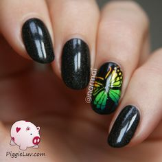 I made this rainbow butterfly that I've had in my head for a while. I used Parrot Polish Aeon Flux for these beautiful black holographic nails and Serum No. 5 for the glow in the dark gradient. I also made a video tutorial so come see!