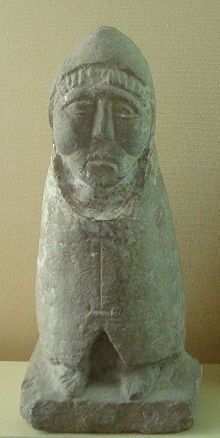 Gallo-Roman limestone statue of Telesphorus discovered in 1884 in Moulézan (southern France), now exhibited in the Archeological Museum of Nîmes. The god is dressed in the hooded cape typical of the depiction of Celts in Roman Gaul.