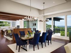 Blue dining chairs add a nice touch