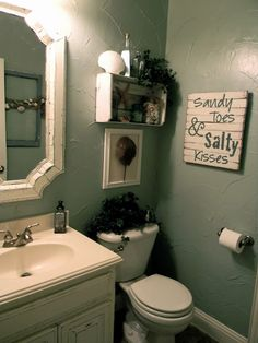 Beach themed bathroom; not a fan of the theme, but I like the placement of the accessories.