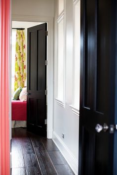 ohh, love the idea of black interior doors!! I like the black doors, but where are your interior doors? Will they be against the new hardwood floors or against the tile? I think I like black trim better than white or grey trim (baseboards and door molding).