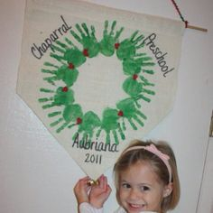 Handprint wreath. Great gift and I'm always a sucker for anything involving handprints!  Just need paint, burlap, stick and yarn