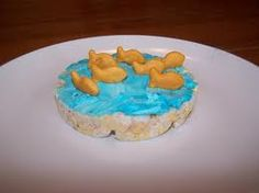 Floating Fish:  Put blue tinted cream cheese on a rice cake. Add goldfish for a fun snack for ocean or fish theme.  Beach party!!